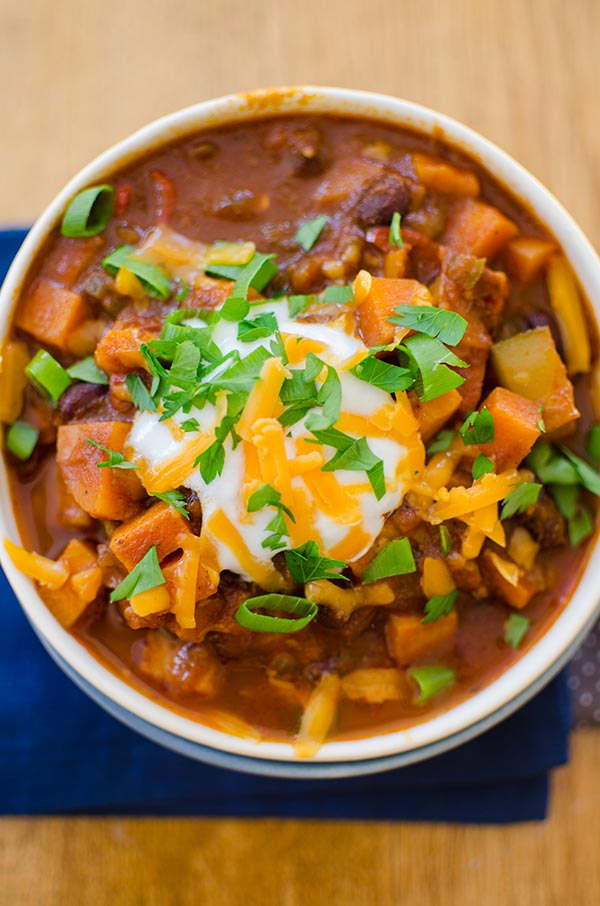 Hearty vegetarian chili with black beans, sweet potatoes, carrots, zucchini and mushrooms.   livinglou.com