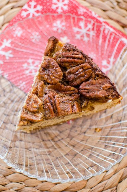Inspired by a favourite holiday pie, this pecan pie cheesecake has a gooey pecan topping. | livinglou.com