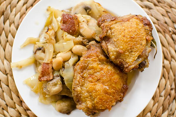 One pan braised chicken with white beans and cabbage. | livinglou.com