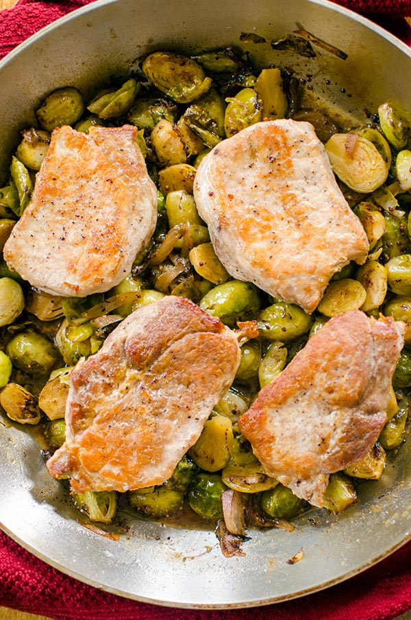 A quick dinner, this recipe for one-pan pork chops and Brussels sprouts is an easy dinner for the whole family.   livinglou.com