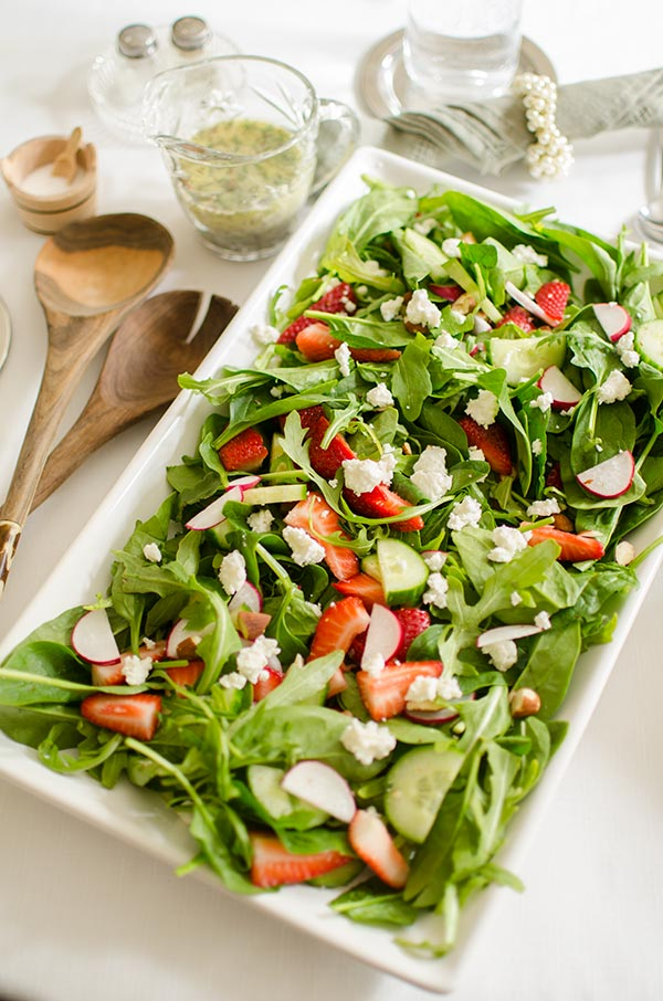 Strawberry spinach salad with almonds, arugula and a homemade poppy seed dressing with fresh thyme. | livinglou.com