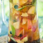 Peach sangria with blueberries, basil and rose for a crowd for a refreshing summer cocktail. | livinglou.com