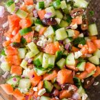 Greek watermelon feta salad is a refreshing summer salad with a lime vinaigrette and fresh mint. | livinglou.com