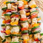Grilled salmon skewers with zucchini, onion and bell peppers are marinated in a olive oil, lemon juice and dried thyme marinade. | www.livinglou.com