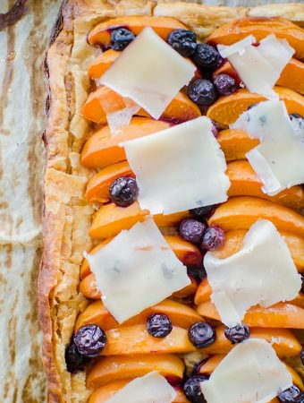 Make the perfect summer dessert with this simple puff pastry apricot blueberry tart topped with Tipsy cheese. | livinglou.com