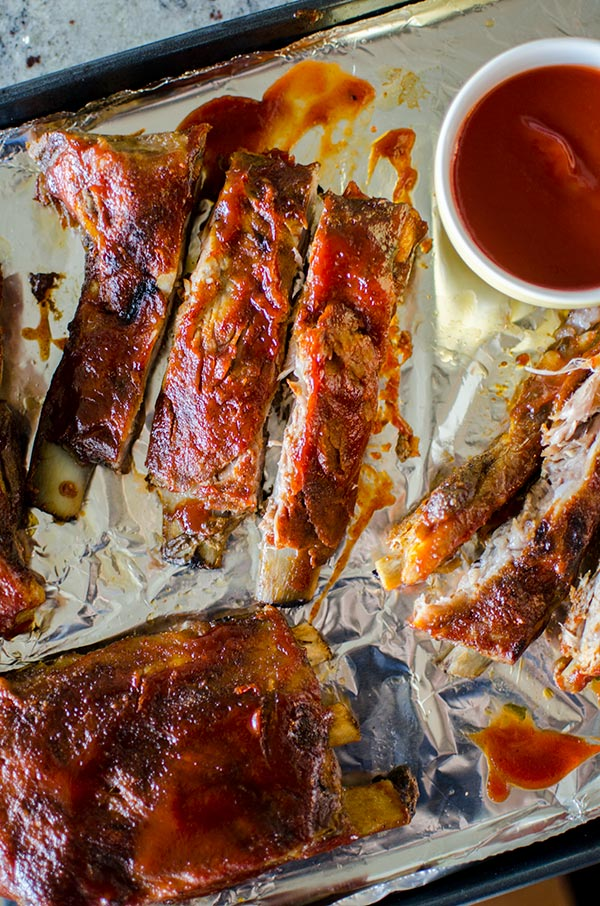 Easy slow cooker pork ribs with a homemade smoky barbecue sauce. | livinglou.com