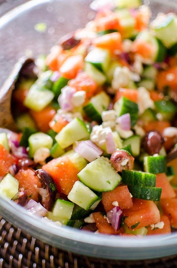 Greek watermelon feta salad is a refreshing summer salad with a lime vinaigrette and fresh mint. | livinglou.com
