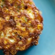 Cheesy corn fritters are the perfect summer side dish with fresh corn, cheddar cheese, green onions and jalapenos. | livinglou.com