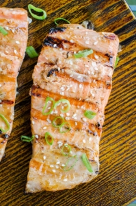 Grilled salmon with a Dijon and maple syrup marinade is the perfect and simple way to grill fish this summer. | livinglou.com