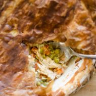 Turn Thanksgiving leftovers into a delicious turkey pot pie with carrots, parsnips, peas and a delicious and easy puff pastry crust.