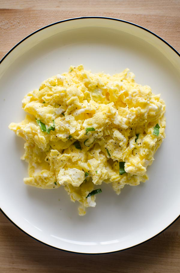 Elevate your breakfast with a restaurant worthy recipe for truffled scrambled eggs made with truffled Monterey Jack cheese and green onions. | LivingLou.com