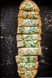 Herbed cheesy garlic bread is the perfect appetizer for a crowd.| livinglou.com