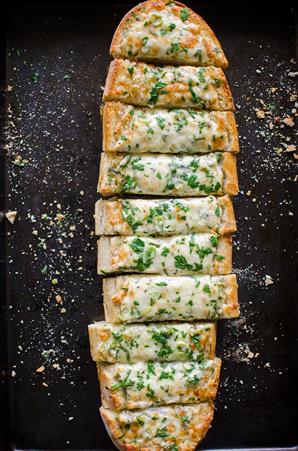 Cheesy herbed garlic bread is the perfect appetizer for a crowd.| livinglou.com