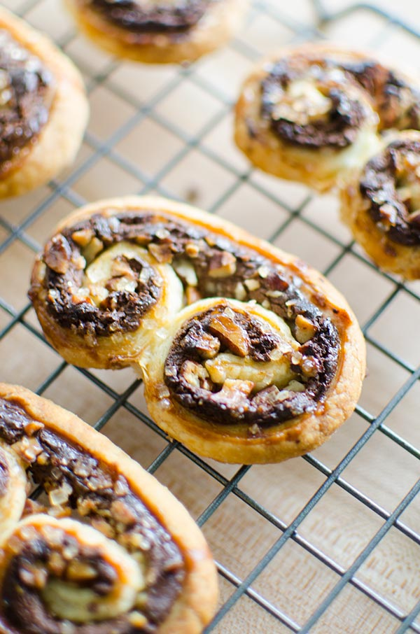 Puff pastry palmiers are an impressive dessert that are so easy to make with frozen puff pastry, chocolate, pecans and cream cheese. | livinglou.com