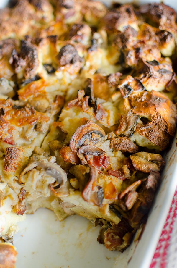 Serve the ultimate holiday brunch with this no-fuss and simple recipe for overnight smoked cheddar, bacon and mushroom strata. | livinglou.com