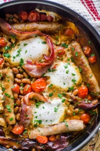 Make a full English breakfast in one pan with cherry tomatoes, bacon, sausages, baked beans and eggs. | livinglou.com