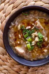 Make slow cooker brown rice chicken congee for the perfect comfort food this winter, loaded with fresh ginger. | livinglou.com
