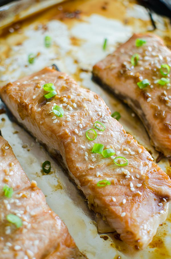Get dinner together quickly with this simple recipe for roasted teriyaki salmon with a homemade teriyaki sauce made with soy sauce, ginger and garlic.