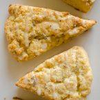 Light and fluffy homemade lemon scones with a lemon glaze and sprinkled with lavender. | livinglou.com