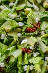 Grilled asparagus salad with basil vinaigrette is the perfect early summer salad with avocado, goats cheese and sundried tomatoes. | livinglou.com