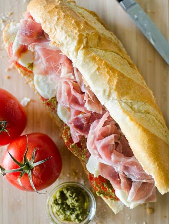 Prosciutto Mozzarella and Pesto-Marinated Tomato Sandwich