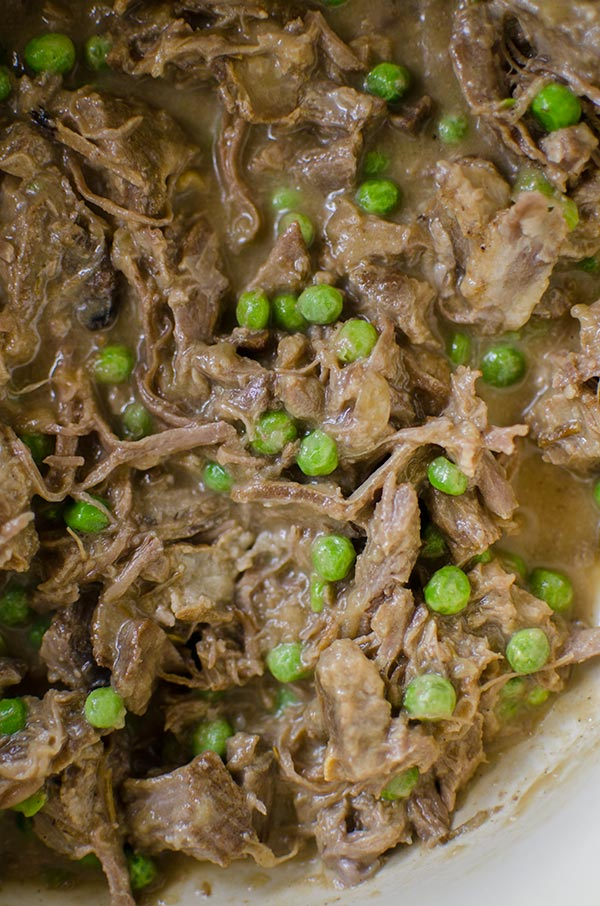 Make a delicious pasta with a slow braised lamb ragu made with lamb shoulder chops and peas.   livinglou.com