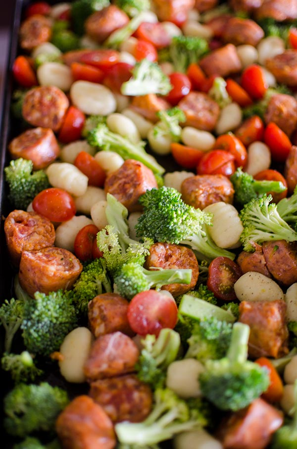 Sheet pan oven baked gnocchi with sausage and vegetables is a quick dinner made in one pan. | livinglou.com