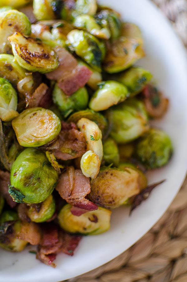 Make the best Brussels sprouts this holiday season with this recipe for Brussels sprouts with bacon and onions with sage and maple syrup. | livinglou.com