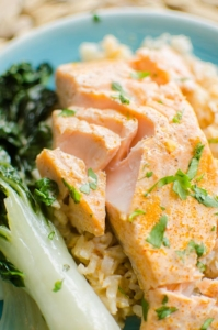 Flakeed poached salmon fillet with bok choy and cilantro.