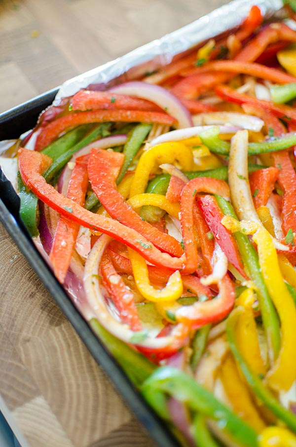 Bell peppers and onions in a fajita marinade.