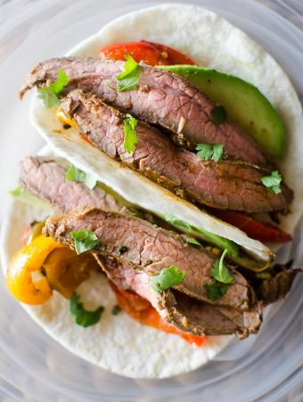 Flank steak fajitas with avocado and bell peppers. livinglou.com