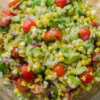 Avocado corn salad in a glass bowl.