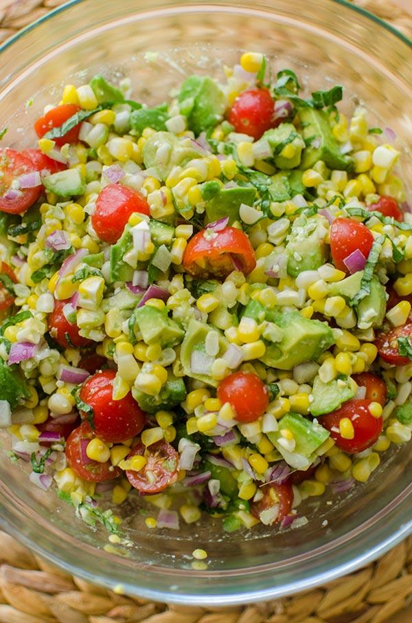 Avocado corn salad in a glass bowl.