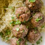 Korean meatballs on jasmine rice in a bowl with cilantro sprinkled on top.