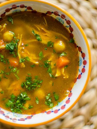 Moroccan chicken soup in a bowl with cilantro.