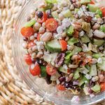 Easy mediterranean bean salad in a glass bowl.