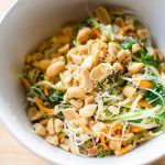 Vermicelli noodle salad in a bowl topped with salted peanuts
