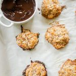 Cinnamon macaroons with a pot of melted chocolate.