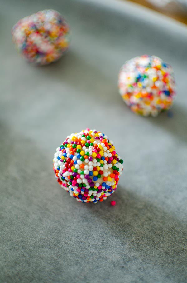 Raw cookie dough ball rolled in sprinkles