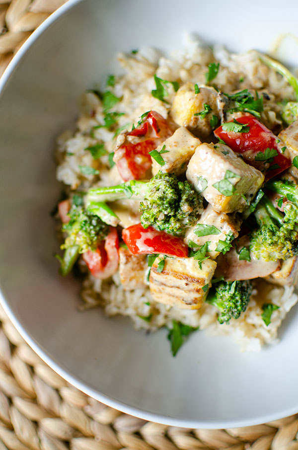 Tofu stir fry in a white bowl