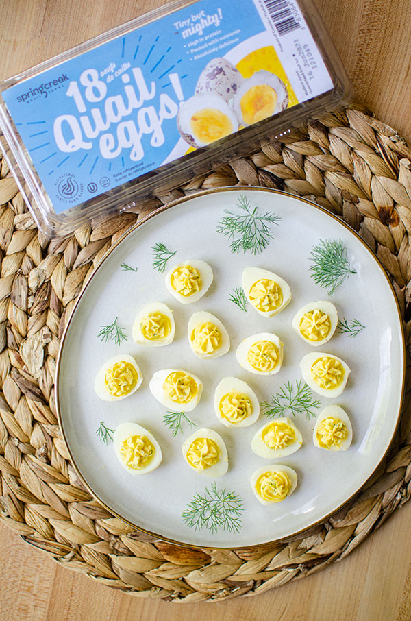 plate of deviled quail eggs with spring creek carton